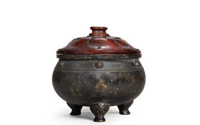 A gilt-splashed bronze tripod incense burner