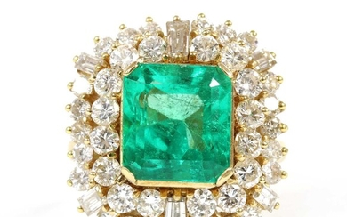 A gold Colombian emerald and diamond cluster ring