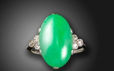 A jade and diamond ring, the green jadeite jade cabochon set with a trefoil of old circular-cut diamonds in white gold, size Q