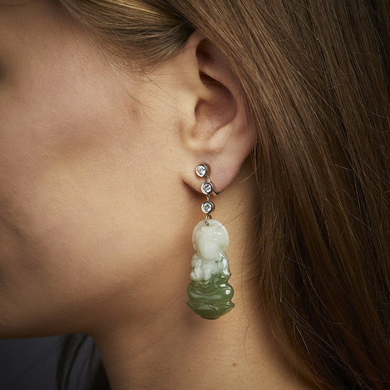 A jade, diamond and gold pair of ear pendants by...