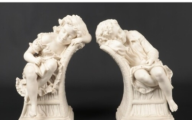 A large pair of Victorian Parian sculptures modelled as chil...