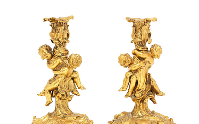 A pair of 19th century French gilt bronze figural candlesticks