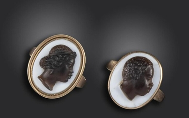 A pair of 19th century blackamoor cameo rings, each mounted with a hardstone cameo of a blackamoor, female and male, in closed-back yellow gold mounts, size N 1/2 and size N