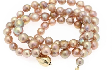 A pearl necklace set with numerous cultured freshwater pearls, clasp of gold plated sterling silver....
