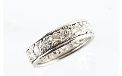 A platinum or white gold diamond eternity ring, the eighteen...