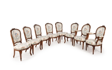 A set of eight Louis XV/Louis XVI transitional walnut and upholstered dining chairs