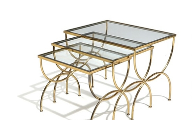 A set of three French 20th century brass nesting tables, glass tops with mirror edges. H. 39. L. 50. W. 37 cm. (3)