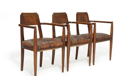 A set of three circa 1900 mahogany Art Noveau armchairs, back carved with foliage, upholstered with patinated leather fitted with nails. (3)