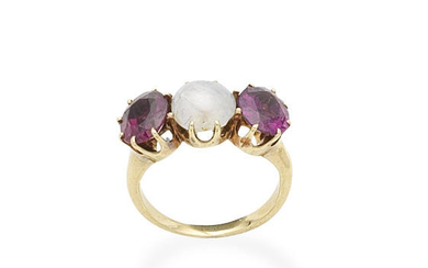 A star sapphire and garnet three-stone ring