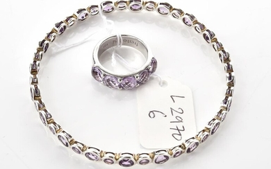 AN AMETHYST SET JEWELLERY SET IN SILVER, COMPRISING A RING (SIZE N) AND A BANGLE (INNER DIAMETER 66MM)