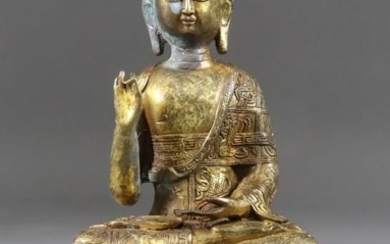 An Indo Chinese Gilt Bronze Figure of a Seated...