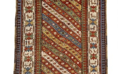 An antique Gendje rug, Caucasus. Design with diagonal stripes in different colours surrounded by crab main border. 19th century. 228×126 cm.