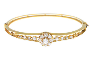 An early 20th century gold old-cut diamond hinged bangle.