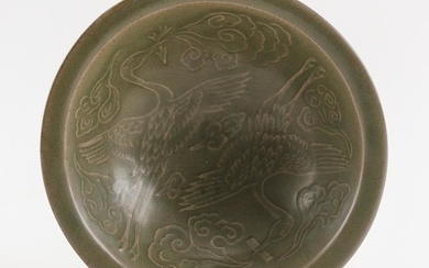 """CHINESE CARVED CELADON STONEWARE BOWL Crane design on interior and pierced floral design on exterior. Diameter 7.2""""."""
