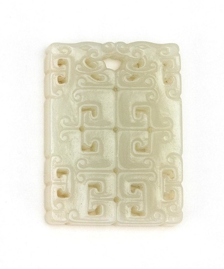 "CHINESE WHITE JADE PENDANT Pierced rectangle, with stylized dragon design. Length 1.8""."