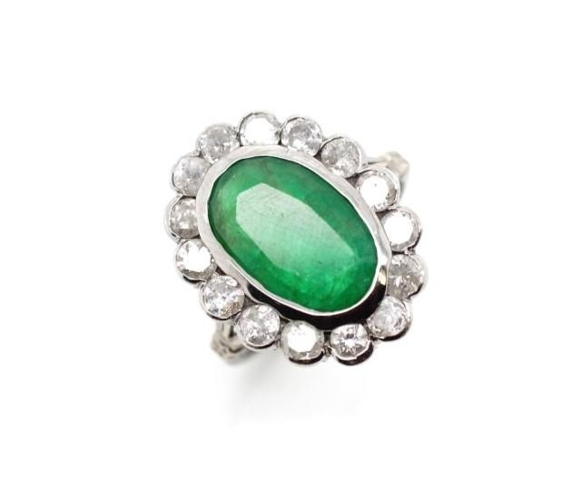 Emerald and diamond halo ring set in 18ct white gold and pal...