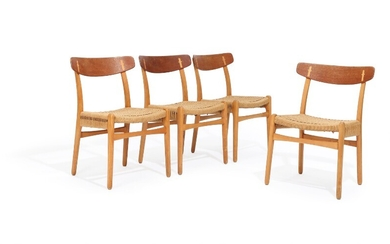 """Hans J. Wegner: """"CH 23"""". Four beech and teak chairs with woven papercord. Manufactured by..."""