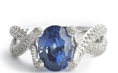 Hartmann's: A sapphire and diamond ring set with an oval-cut sapphire weighing app. 3.98 ct. and diamonds weighing a total of app. 1.22 ct., mounted in 18k.