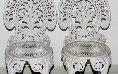 PAIR OF WHITE PAINTED CAST IRON SIDE CHAIRS