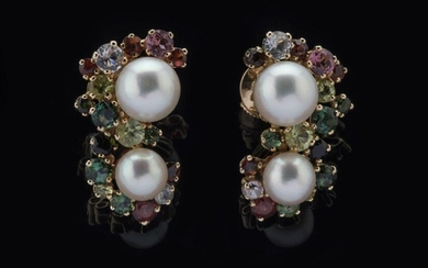 Pair of EARRINGS each decorated with two cultured pearls and a total of thirty-two fine stones including: ten red garnets, four aquamarines, two pink tourmalines, fourteen green tourmalines, two peridots mounted in claws. Alpa clasps. Diameter of the...