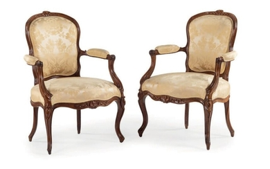Pair of convertible armchairs in moulded and carved...