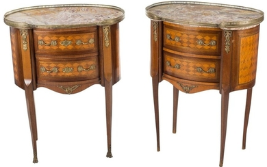 Pair of jokers from the Herráiz house in Louis XVI style in mahogany wood and rhombus marquetry. They have two drawers at the front and gilded bronze applications. White marble veined envelope and bronze baluster. Stamped. Clean. XXth century. One of...