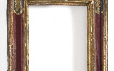 Probably Spanish frame in red painted wood, rectangular in shape, with foliage decoration on a green background in the spandrels. 18th century 50 cm x 41 cm View: 32.4 cm x 24 cm (accidents and restorations).
