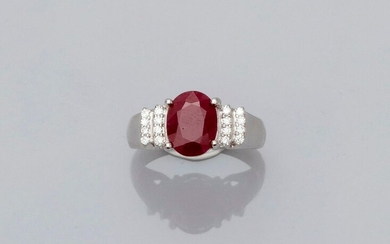 Ring in white gold, 750 MM, set with an oval ruby weighing about 3 carats, stepped with diamond steps, size: 55, weight: 4.7gr. rough.