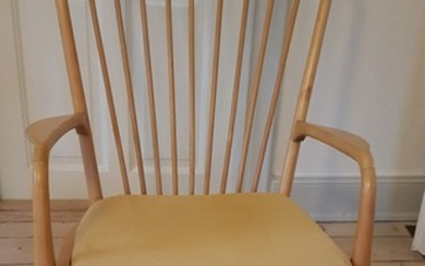 Unknown designer: An easy chair of birch. Cushion upholstered with yellow fabric. Probably designed and manufactured in Sweden. H. 100 cm. W. 68 cm.