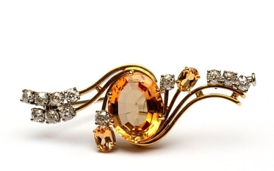 18krt. Gold brooch, set in the middle with...