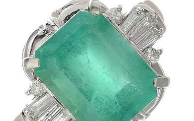 An emerald and diamond ring dress ring.