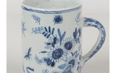 A 19th century blue and white delft cylindrical tankard with...