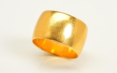 A 22CT GOLD RING, a plain polished band, with a 22ct hallmar...