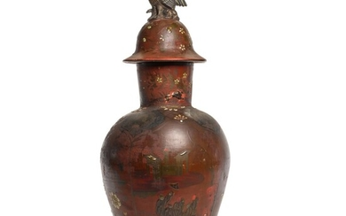 A Berlin lacquered fayence baluster vase and cover, 19th century