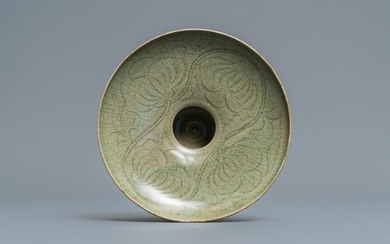 A Chinese Yaozhou celadon bowl with incised floral...