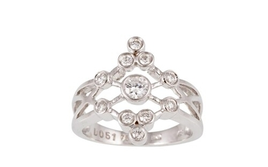 A DIAMOND DRESS RING, of open worked cluster design, set wit...