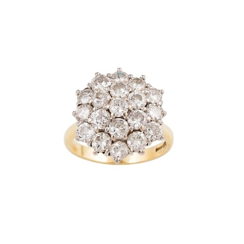 A DIAMOND SHAPED CIRCULAR CLUSTER RING, mounted in 18ct yell...
