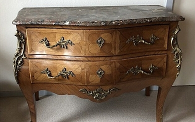 A French walnut rococo style chest of drawers, c. 1930. With top of marble. H. 85. W. 114. D. 62 cm.