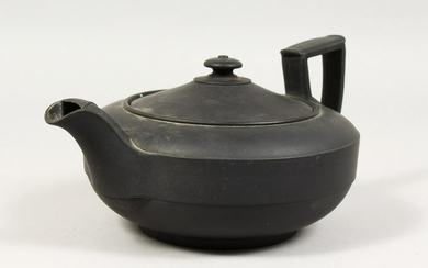 A LARGE PLAIN WEDGWOOD BLACK BASALT CIRCULAR TEAPOT AND
