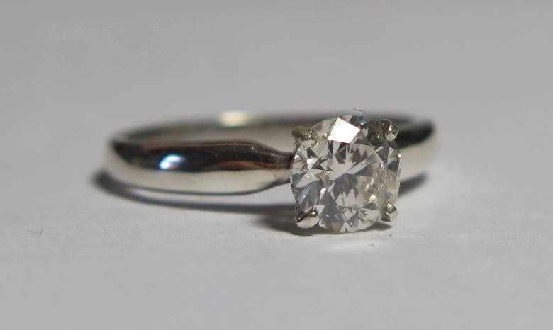 A Modern 18ct White Gold Diamond Solitaire Ring, size L.5, 2...