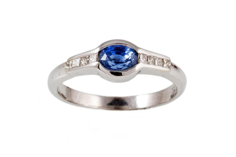 A SAPPHIRE AND DIAMOND RING,the central oval sapphire of fl...