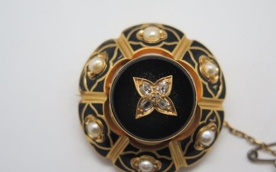 A Victorian gold diamond and pearl brooch set with black ena...