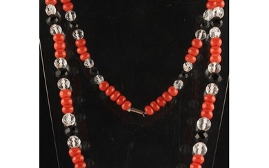 A coral jet & crystal bead necklace, the largest coral bead ...