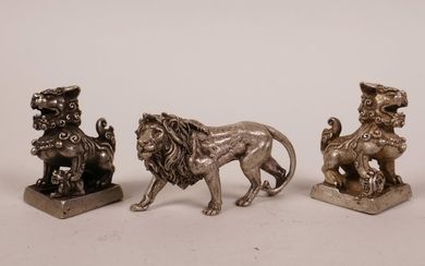 A pair of Chinese white metal seals in the form of kylin, to...