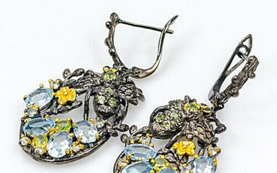 A pair of ear pendants each set with numerous oval and circular-cut topazes, peridots and citrines, mounted in black rhodium and gold plated silver.