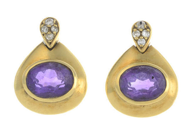 A pair of oval-shape amethyst and brilliant-cut diamond earrings.