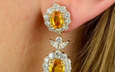 A pair of yellow sapphire and vari-cut diamond floral cluster drop earrings.