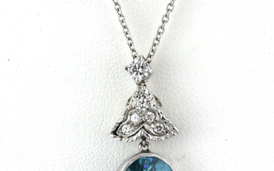 A white metal (tested high carat gold) pendant set with an old oval cut blue stone and diamonds on a 950 platinum chain.