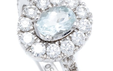 AN 18CT WHITE GOLD AQUAMARINE AND DIAMOND CLUSTER RING; centring an approx. 0.70ct aquamarine to surround and shoulders set with 30...