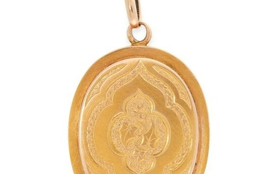 AN ANTIQUE MOURNING LOCKET PENDANT in yellow gold, the
